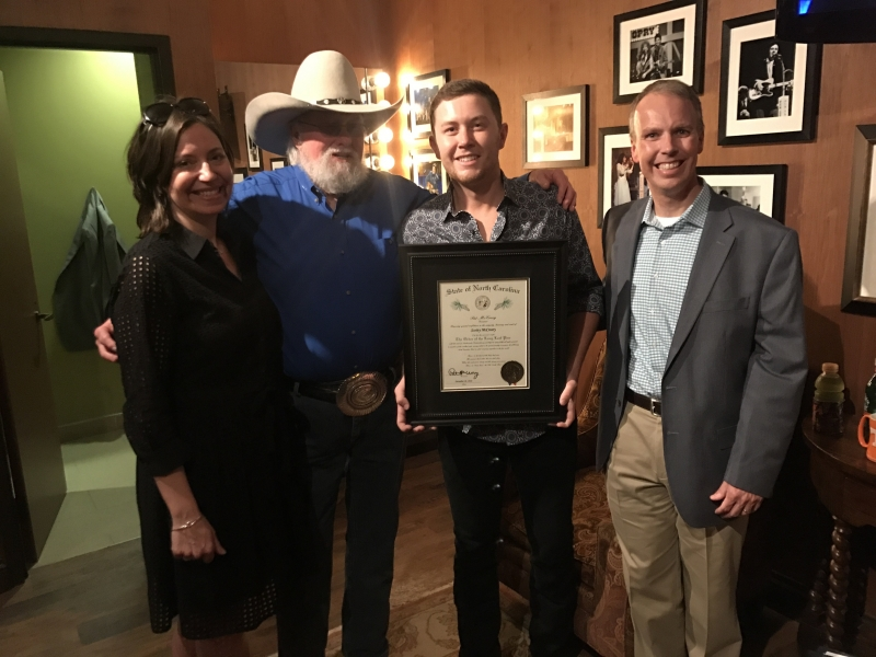Scotty McCreery receives the prestigious Order of the Long Leaf Pine Award from the State of North Carolina at the Grand Ole Opry.  Credit: Scott Stem